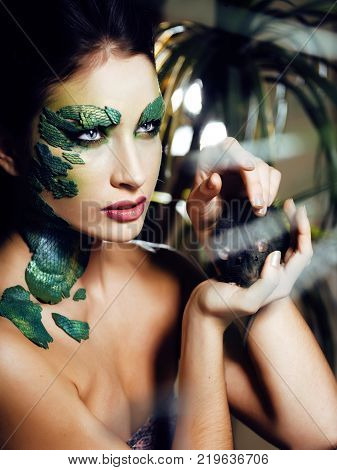 woman with creative make up like snake and rat in her hands, halloween horror closeup joke scary, crazy wild concept close up