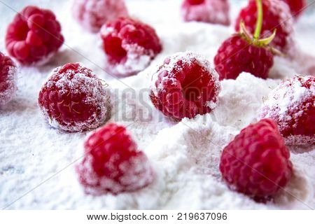 Raspberry Fruit Background. Fresh Raspberries Background Closeup Photo. Raspberry In Powdered Sugar