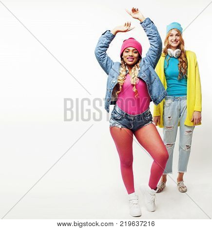 diverse nation girls group, two diverse rase teenage friends company cheerful having fun, happy smiling, cute posing isolated on white background, lifestyle people concept close up, african american and caucasian young woman