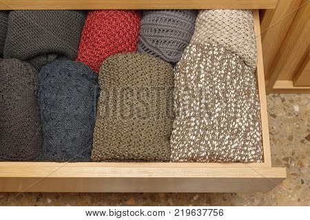 A well-organized closet drawer open. Storage system. Wardrobe order.