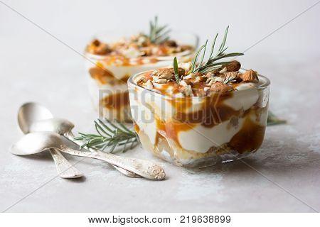 Dessert bowl with tasty caramel parfait on table. parfait parfait parfait parfait