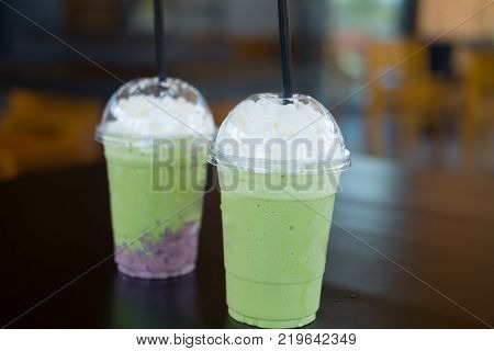 Milk green tea smoothie and Red bean milk green tea smoothie with whipped cream