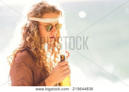 Beautiful free hippie girl blowing smoke. High stoned relax - Vintage effect photo poster