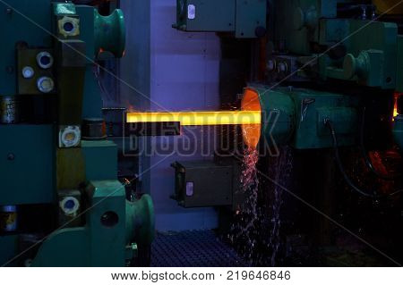 Iron factory with hot candent block of iron or steel or zinc in process of production