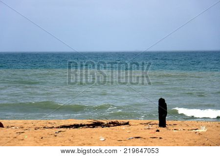 blue sky Near the evening with cloudy and rolling tidal waves on a sandy beach in Yaring, Pattani, Thailand