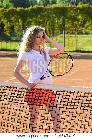 Woman Player With Tennis Racket On Sunny Day