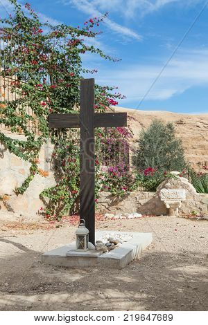 Near Mitzpe Yeriho Israel November 25 2017 : A large wooden cross near the grave in the cemetery in the monastery of St. George Hosevit (Mar Jaris) near Mitzpe Yeriho in Israel