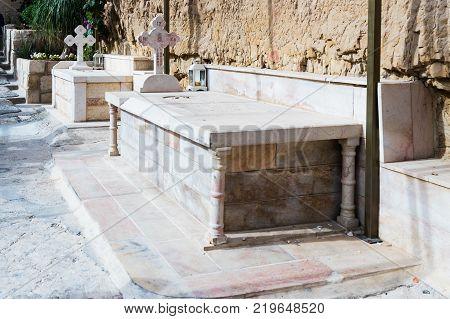 Near Mitzpe Yeriho Israel November 25 2017 : Sarcophagus with burial on the territory of the monastery of St. George Hosevit (Mar Jaris) in Wadi Kelt near Mitzpe Yeriho in Israel