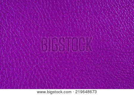 Texture of artificial leather. Lilac background or backdrop of leatherette. Fine embossing.