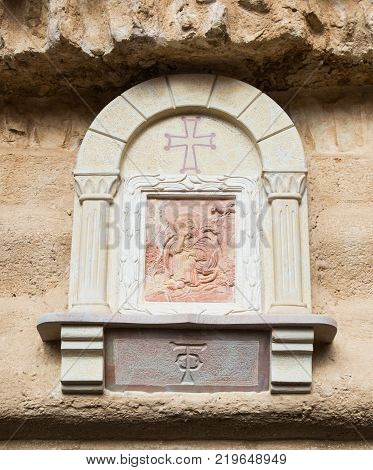 Near Mitzpe Yeriho Israel November 25 2017 : Icon - bas-relief on the wall in the courtyard of the monastery of St. George Hosevit (Mar Jaris) in Wadi Kelt near Mitzpe Yeriho in Israel