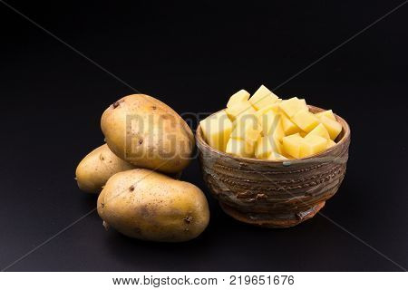 Chopped potato in a bowl isolated on a white background.