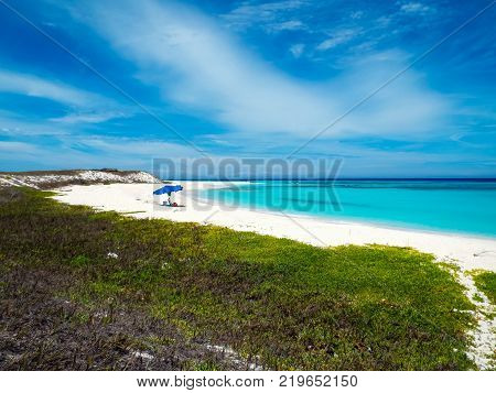 Amazing tropical beach with white sand and crystalline water in Cayo de Agua (Los Roques, Venezuela).