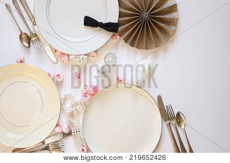 Pink and white vintage table setting with wedding décor. Copy space.