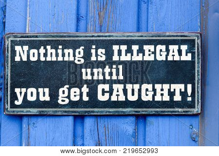 Nothing is illegal until you get caught plate on a wall