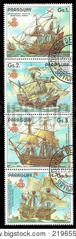 Paraguay - circa 1987: Coupling Stamps printed by Portugal Color edition on 500th anniversary of the discovery of America shows Spanish Galleon ships Victoria San Hermenegildo San Martin circa 1987