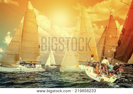 Sailboats.Team athletes participating in the sailing competition - yacht race, regatta. Recreational Water Sports, Extreme Sport Action. Healthy Active Lifestyle. Summer Fun Adventure. Hobby