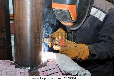 Welder In The Shop Weld Sample From The Tube With Concomitant Heating For Attestation