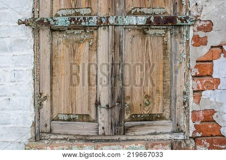 Close up image of obsolete wooden window shutters