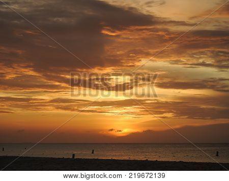 Travel photography - amazing sunset in Aruba beach (Dutch Antilles).