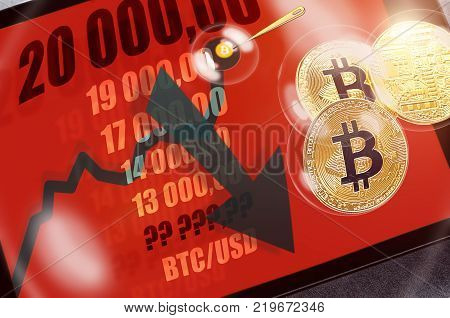 Bitcoin cryptocurrency chart on tablet pc with arrow pointing down, recession. Sharp falling stock market price. Risk of investing in bitcoin. Concept of economic (financial, speculative) bubble.