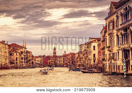 The famous Grand Canal at sunset in Venice, Italy. Grand Canal is one of the major water-traffic corridors in Venice.