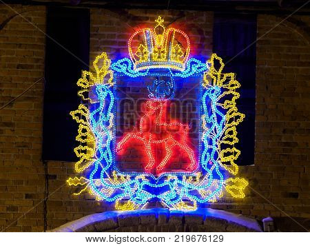 winter night view of coat of arms of Nizhny Novgorod on the Kremlin wall