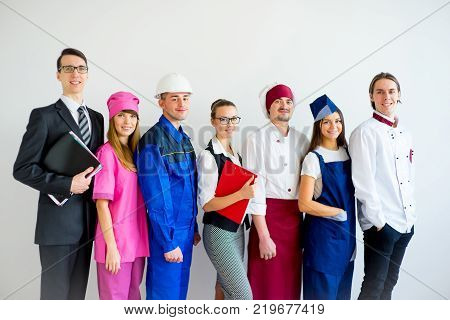 Group of people of different professions on white background