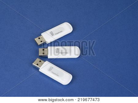 USB keys to save data on the bue background