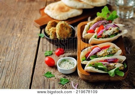 Baked Falafel vegetables lemon Tahini sauce Pita sandwich