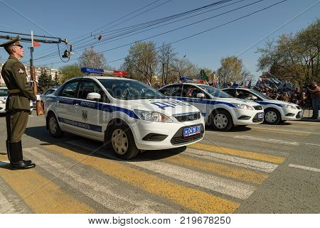 Tyumen, Russia - May 9. 2009: Parade of Victory Day in Tyumen. Police cars move on parade