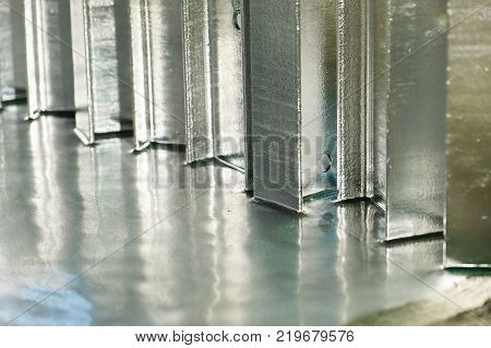 Hot dip galvanizing of metal constructions in bath with hot zinc, close-up