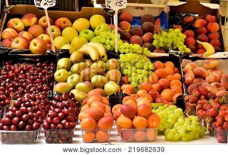 Food market.Sale of fruit in the market.Good harvest.Large range of fruits.Consumer basket.