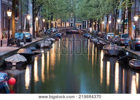 Amsterdam, Netherlands - April 21, 2017: One of the channels in Amsterdam with many boats.