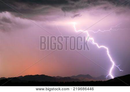 A bright lightning strike illuminating the Buckeye Foothills in Arlington Arizona during the 2012 Monsoon season.