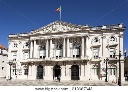 LISBON - September 25, 2017: The City Hall neoclassical building featuring sculptures on the triangular tympanum supported by four paired Corinthian columns in Municipal Square Lisbon Portugal