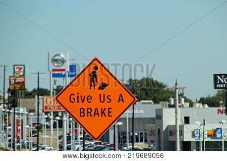 FORT WORTH, TEXAS - OCTOBER 07: Give Us A Brake Construction Traffic Sign Texas 2013