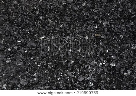 Enriched wet coal anthracite fine fraction under low light.