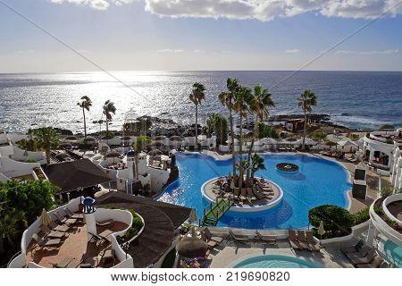 TENERIFE, CANARY ISLANDS, SPAIN - DECEMBER 7, 2017: Beautiful pool at Santa Barbara ocean club resort in Tenerife, Canary Islands. SPAIN.