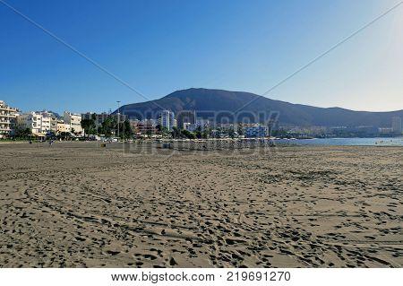 TENERIFE, CANARY ISLANDS, SPAIN - DECEMBER 7, 2017: Beautiful Beach Los Cristianos in Tenerife, Canary Islands. SPAIN.