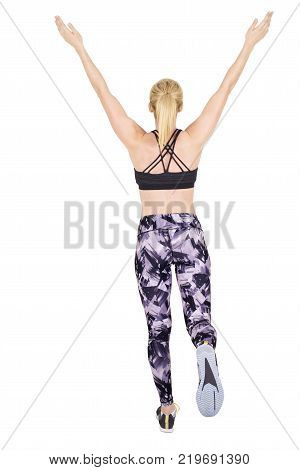 Running woman seems to win a course and lifting arms in sign of victory isolated on white background.
