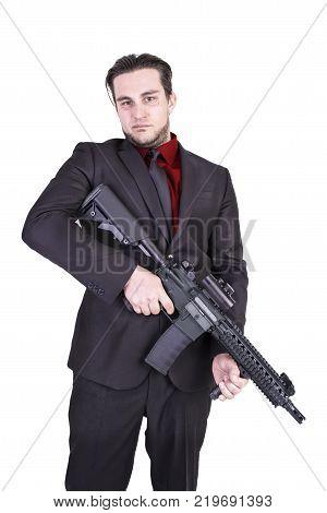 Elegant gangster holding rifle gun isolated on white background.
