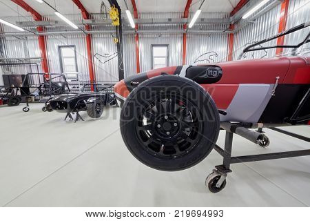 MOSCOW, RUSSIA - OCT 27, 2017: (PR) Racing cars based on Lotus Seven on racks in garage of DB 527 company producer of russian sports cars.