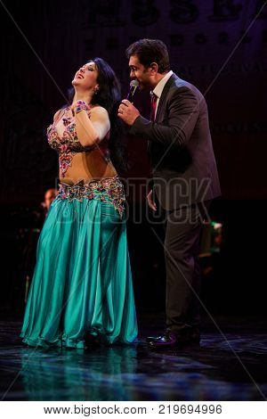 MOSCOW, RUSSIA - OCT 21, 2017: Nour and Yasser Alama organizers of 12th international festival of oriental dance ASSEMBLY 2017 on stage of Luna Theatre during Gala Concert.