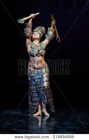 MOSCOW, RUSSIA - OCT 21, 2017: Belly dancer with clubs in egyptian suit performs on stage of Luna Theatre during Gala Concert after 12th international festival of oriental dance ASSEMBLY 2017.