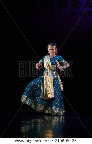 MOSCOW, RUSSIA - OCT 21, 2017: Belly dance performer in indian suit on stage of Luna Theatre during Gala Concert after 12th international festival of oriental dance ASSEMBLY 2017.