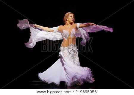 MOSCOW, RUSSIA - OCT 21, 2017: Belly dance performer on stage of Luna Theatre during Gala Concert after 12th international festival of oriental dance ASSEMBLY 2017.