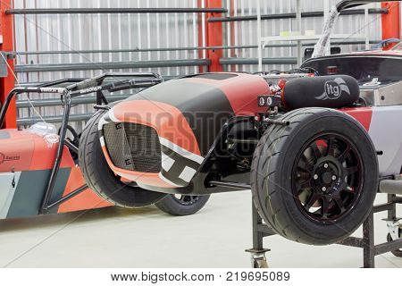 MOSCOW, RUSSIA - OCT 27, 2017: (PR) Racing cars ShortCuts  based on the legendary Lotus Seven on wheeled rack in garage of DB 527 company producer of russian sports cars.