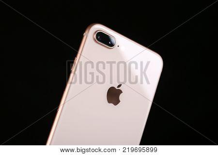 KIEV, UKRAINE - OCTOBER 23, 2017: Back panel of iPhone 8 Plus Gold on black background