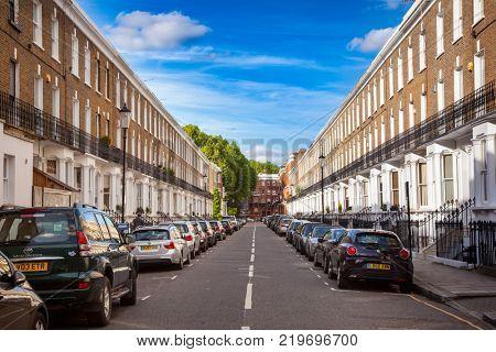 LONDON, UK - JUNE 16, 2013: Cars parked along residental victorian town houses at Redburn Street in Chelsea West London