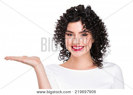 Portrait of amazing beautiful smiling woman with curly hair on white background showing copy space